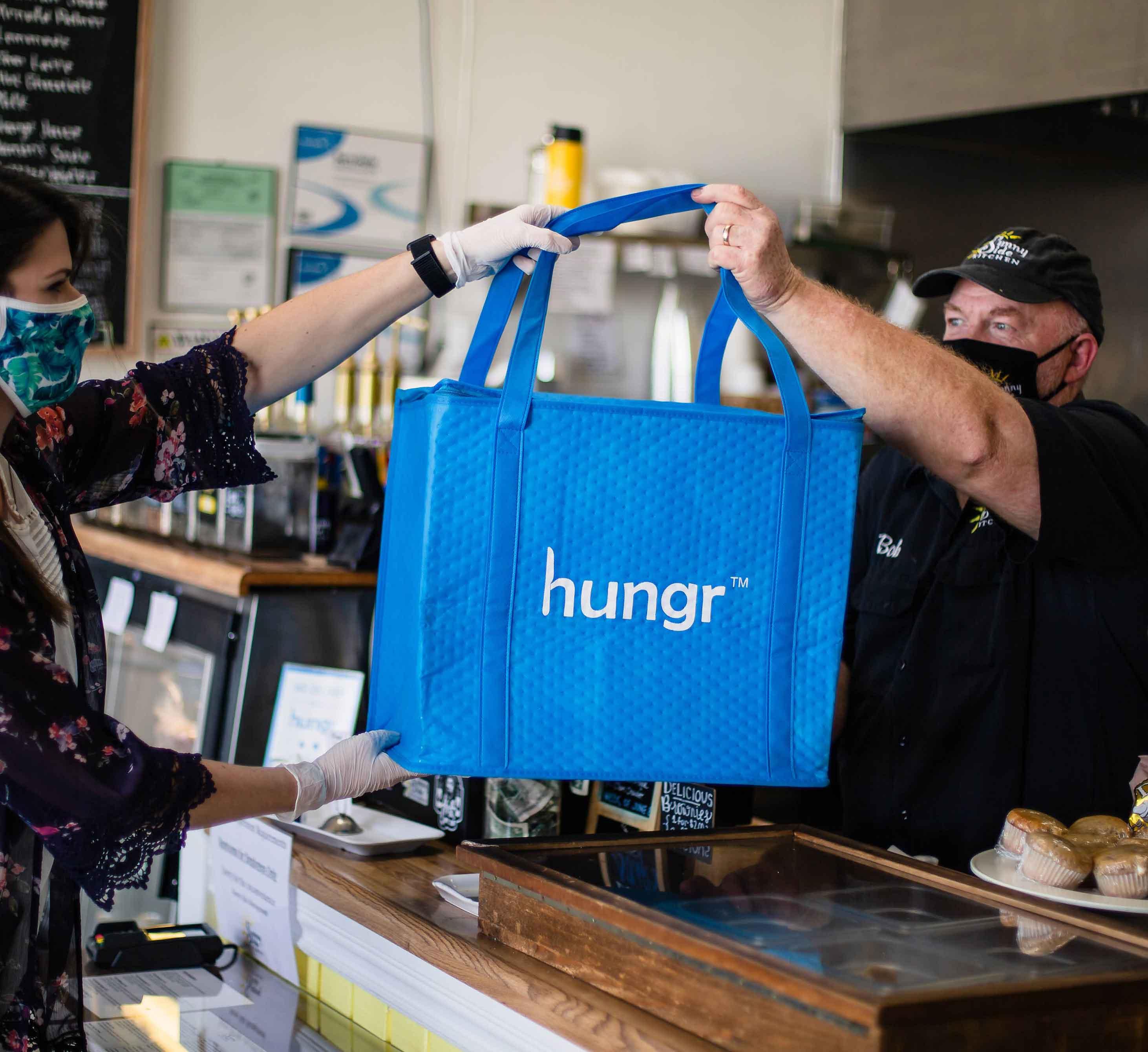 hungr bag being handed off